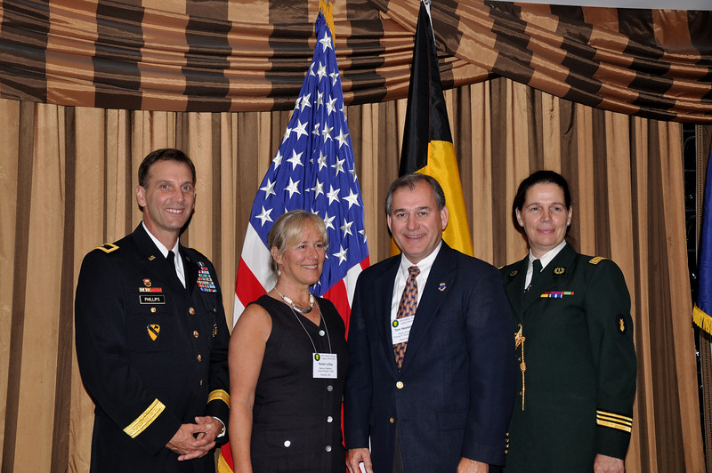 Brigadier General Phillips, Karen Lilley, Tom Hewlett, and Lieutenant Colonel Dierckx