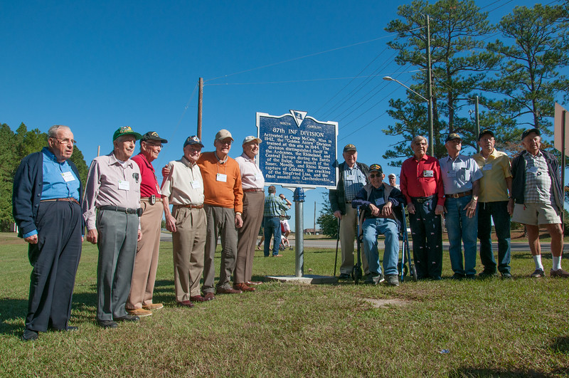 Veterans assembled around the 87th marker.