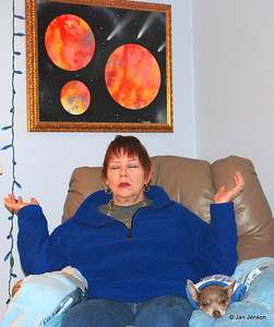 Rev. Diannia Baty during a channeling session at home. That is her painting behind her head...