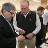 Revolutionary Clinics announced the launch of their wholesale brand strategy which includes a new umbrella brand, Licit Brands, for wholesale customers across the Commonwealth. The announcement continues to support the growth of their cultivation facility, jobs for new light manufacturing, delivery and other ancillary businesses. Fitchburg Mayor Stephen DiNatale learns about their products as he chats with Revolutionary Clinics CEO Keith Cooper after the announcement. SENTINEL & ENTERPRISE/JOHN LOVE