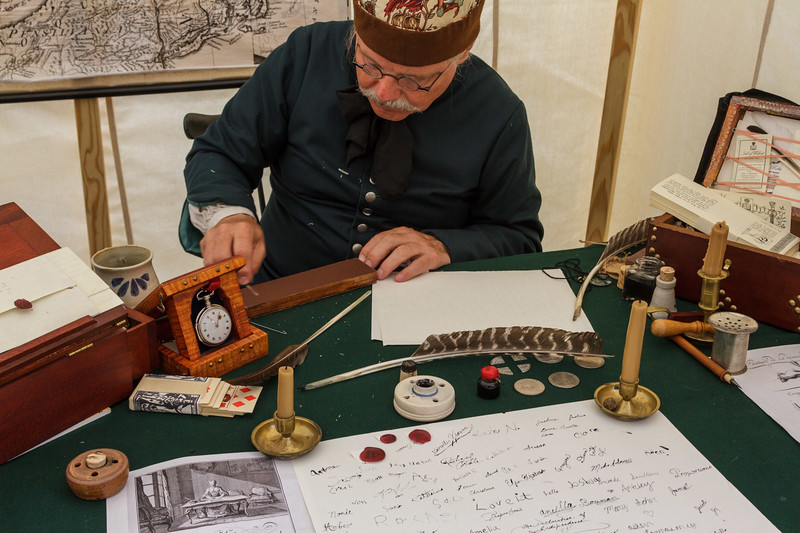 Sharpening the quill knife; in the book binder's tent