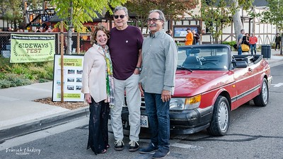 Kathy Joseph (Fiddlehead Cellars), Rex Pickett (author of Sideways), and Frank Ostini (Hitching Post) with the Sideways Saab as they prepare for the Sideways Fest event at the Solvang Festival Theater