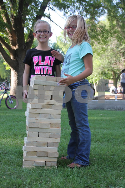 Thursday, August 20, 2015 Reynold's Park held a ribbon cutting and celebration for the new playground equipment that was installed there. Pictured is (left to right): Tristen Holst and Shaylee Lafleur using wooden blocks to play a home made game of Jenga, as they enjoyed the celebration at the park. The event was held at Reynold's Park in Fort Dodge.