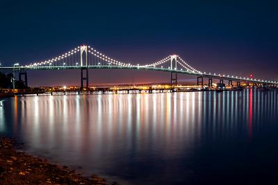 Claiborne Pell Bridge reflected in bay, Jamestown, Rhode Island