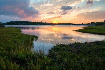 Sunrise reflection in pond, Newport, Rhode Island - stock photo