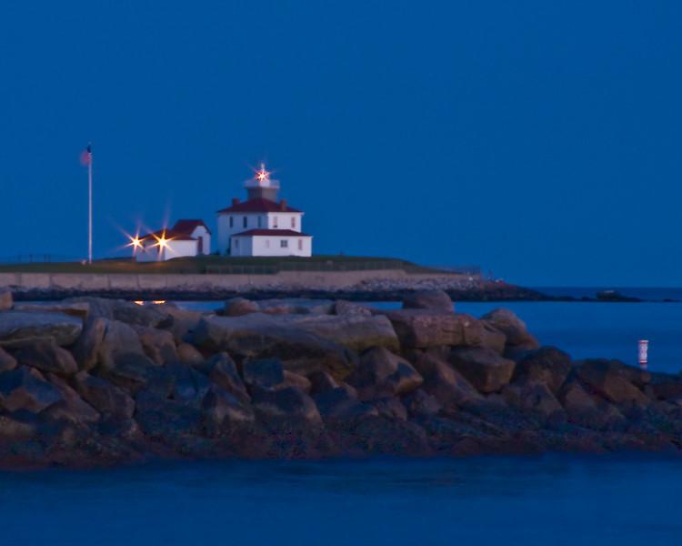 Watch Hill Light at night across Little Narragansett Bay