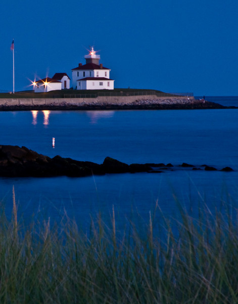 Watch Hill Light at night across Little Narragansett Bay