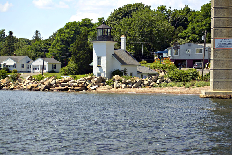 By August 1855 a new lighthouse tower and attached Keepers residence was completed 53 feet north of the private light.