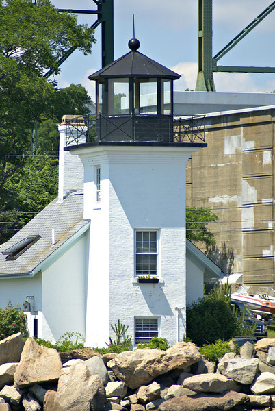 In 1916 an inspection found that the wooden deck and lantern had rotted.  The iron deck and lantern from the discontinued Rondout Creek Light in New York was removed and installed on the Bristol Ferry tower.  At this time the tower was raised an additional 11 feet.