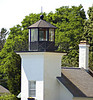 The lantern of the Bristol Ferry Light was originally equipped with a fixed Sixth Order Fresnel lens illuminating a 220˚ arc with a white light.  In August 1902 the lens was upgraded to a fixed Fifth Order Fresnel.