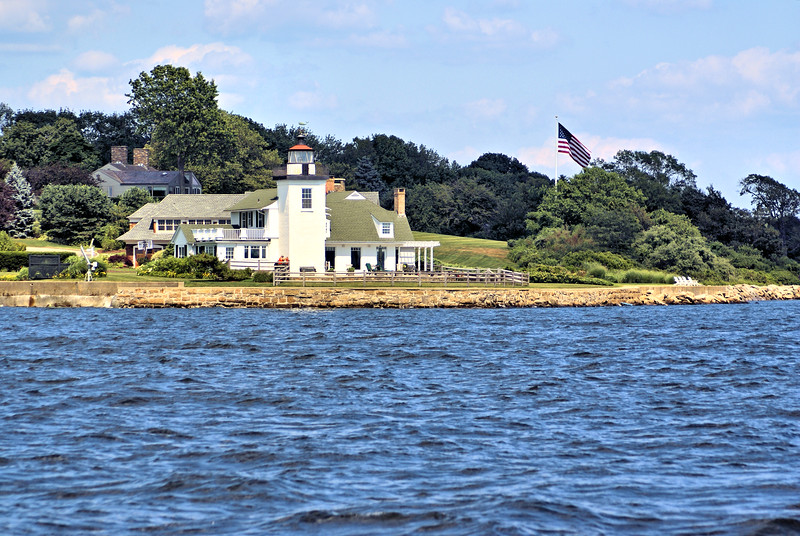 In 1873 a five room Keepers dwelling was erected on a pier next to the Conimicut Point Light for the Keepers and the Nayatt Point dwelling was closed.  However in March 1875 ice floating downriver struck the new Keepers home and destroyed it with the Keeper and his son inside.  They survived by floating on wreckage for several hours until they beached frostbitten but happy to survive.  The Nayatt Point dwelling was reopened and used until the new cast iron Cominicut Point Lighthouse was built in 1883.