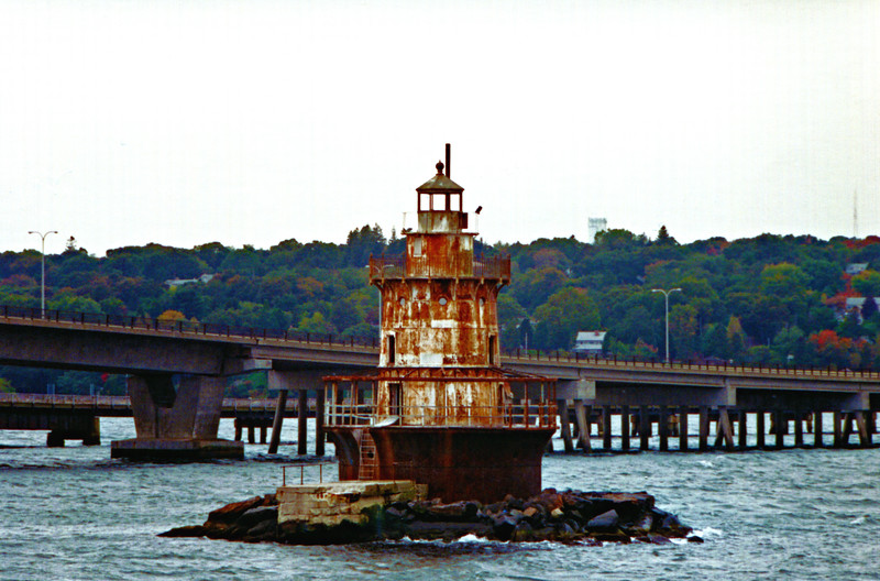 **Plum Beach Lighthouse before restoration** In 1940 the Jamestown Bridge was built across the Western Passage close to the Plum Beach Light rendering it obsolete and it Coast Guard deactivated it in January 1941.  Although it was offered at auction, there were no takers.  Over the years the tower became a rusty eyesore populated with birds and their associated guano.  Years went by and the guano grew deeper and deeper.