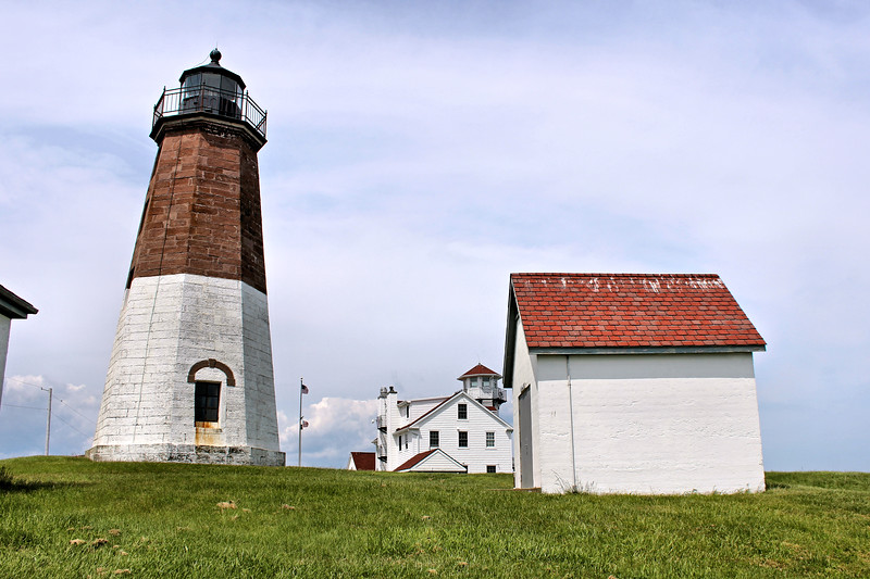 In 1937 the US Coast Guard built administrative and support buildings on the lighthouse reservation.  The famous hurricane of 1938 left Point Judith unscathed, although 250 feet of seawall was destroyed.