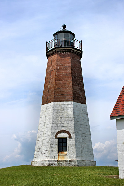 In 1857 a new lighthouse tower and brick dwelling were built to replace the old structures.  The new octagonal tower was 51 feet high and made of brownstone.  It received a Fourth Order Fresnel lens for the lantern giving the light a visibility of 16 miles.
