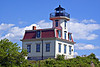 In 1974 the light was discontinued in the lantern and moved to a light on a skeleton tower.  The 4th Order Fresnel lens was removed and loaned to the Custom House Maritime Museum in Newburyport, Massachusetts for display to the public.