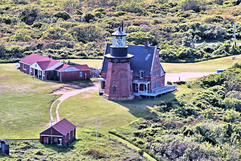 The Light House Board set out to make Southeast Light a showplace to the public.  Their plans called for a Gothic Revival influenced 52 foot red brick tower with an attached 2½ story duplex for the Keepers built upon a granite foundation.