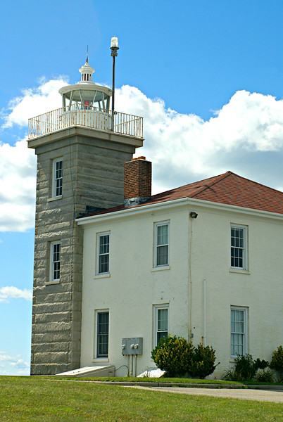In August 1854 Congress appropriated $8,300 to rebuild the Watch Hill Light.  The new 45 foot tower was completed in 1856 and was built with granite blocks quarried in Westerly.  The granite blocks were 12 inches thick, 18 inches high and alternated between 8 and 10 feet of length.  An interesting aspect of the tower is that it has a circular brick interior.