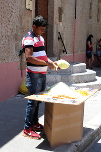 Guy shaving cabbage on the street....