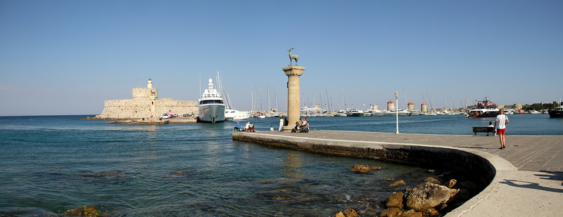 This is a famous part of the harbor because  it is believed that the great statue of Colossus, one of the Seven Wonders of the Ancient World, once stood at the harbor entrance which can be seen here  (click on the link below for a picture of how it might have looked like: http://www.telegraph.co.uk/news/worldnews/europe/greece/12067713/Colossus-of-Rhodes-one-of-the-seven-wonders-of-the-ancient-world-to-return.html ). The monument took 12 years to build, but stood for less than a century, as it was toppled by an earthquake.   There were offers made to rebuild it, but the people did not want to, believing the scupture angered the sun God Helius.  Apparently, its remains lay near the harbor for many centuries, until a Syrian Jew purchased them and had them take to Syria on the backs of 900 camels.Today there are deer sculptures at the entrance.