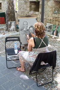 Street artists drawing portraints within the fortress walls.