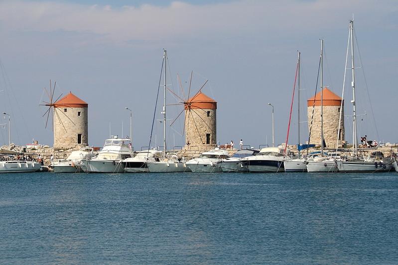 Iconic windmills characteristic of Madraki Harbor.