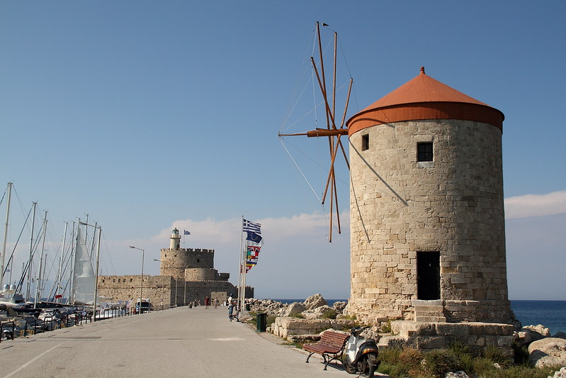 Windmill with fortress behind it.