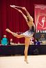 Rhythmic gymnast Maria Kadobina of Belarus performs with clubs during 2013 LA Lights Rhythmic Gymnastics meet in Culver City, CA.  January 26th, 2013 (photo by James Glader)