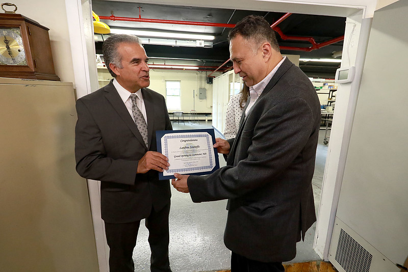 A ribbon cutting for the new Leominster business Landrau Scientific Innovations was held on Thursday at noon, June 28, 2018. After the ribbon cutting Leominster Mayor Dean Mazzarella gave Landrau President/CEO Nelson Landrau a certificate from the city. SENTINEL & ENTERPRISE/JOHN LOVE
