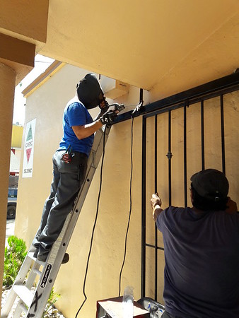 Ricardo  and Martin fix Club door.