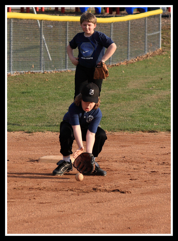 Russell didn't let anything get by him at third base during his first practice of the year.