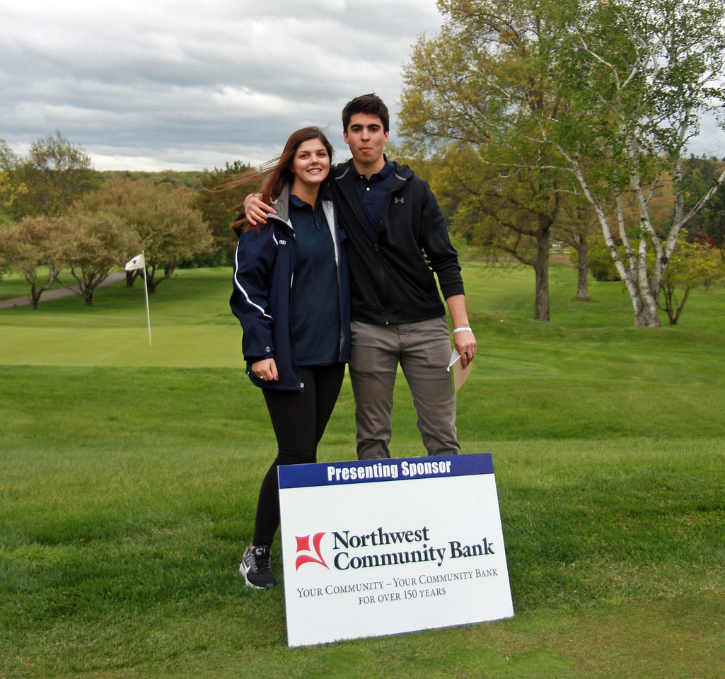 Avon High graduates Brianna Downey and Alex Zacchio volunteer at the putting green