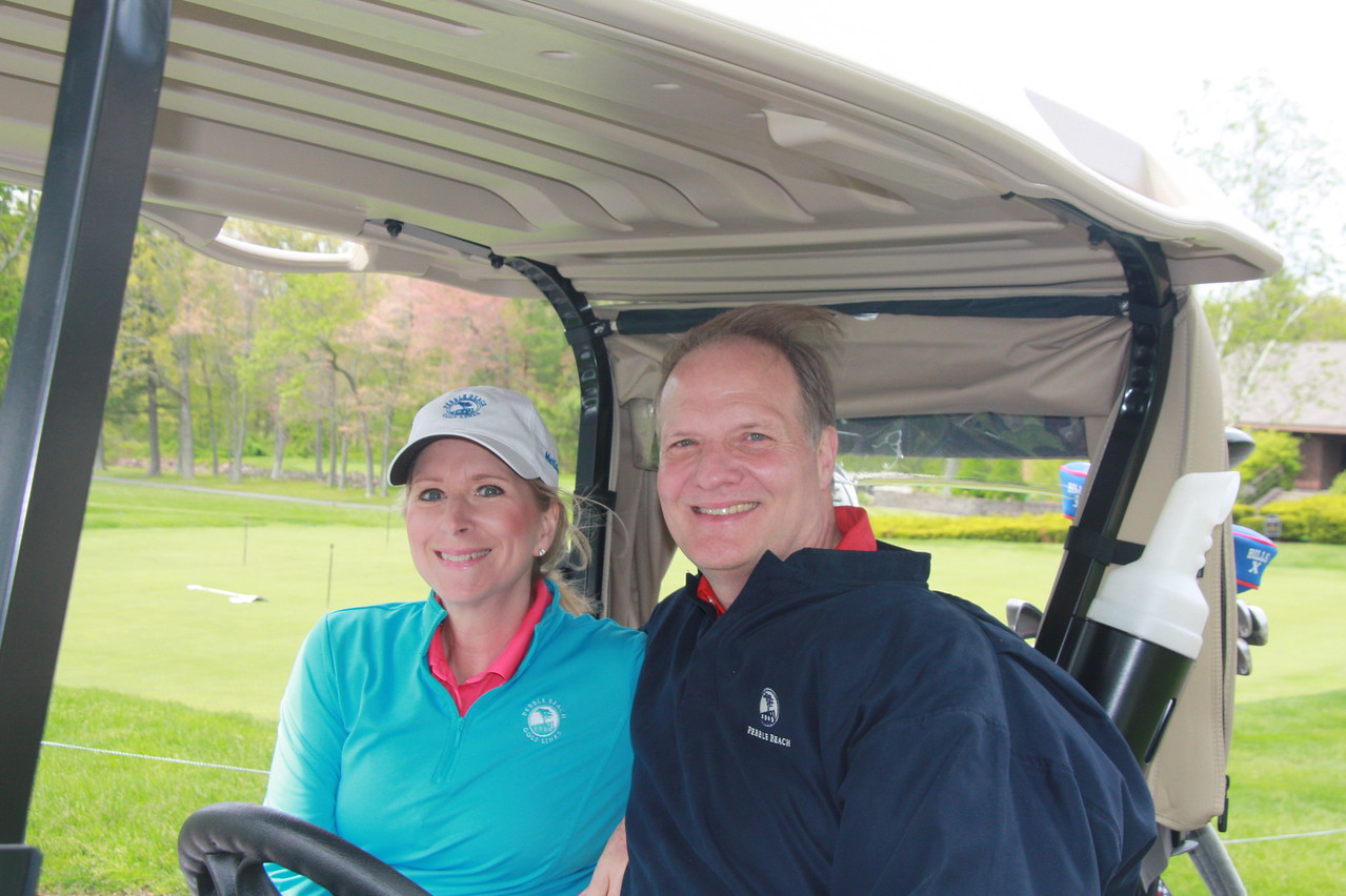 Avon High Booster Club supporters Carolyn and Paul Marshall pause on their way to their first hole.