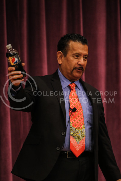 Richard Montañez briefly promotes Pepsi during his inspirational speech, at the Kansas State University Student Union on November 13th, 2017. (Photo by Cooper Kinley | Collegian Media Group)