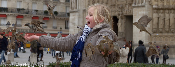 On a Sunday afternoon walking in front of Notre Dame I saw a man teaching children how to feed birds. This young girl caught my eye and the joy on her face was incredible. The birds just surrounded her. People who see this photo or purchased it say how great and happy to makes them feel.