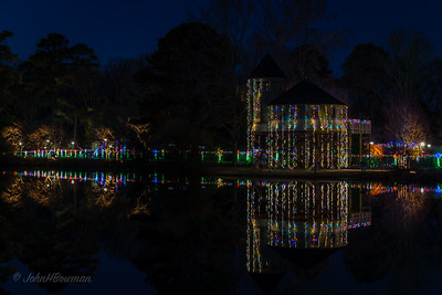 GardenFest of Lights 2013-14, Lewis Ginter Botanical Garden; cold night, with lots of people; Carol & Isabella went with us; polarizer & tripod for all photos, many 30-second exposures, and had to vary aperture and ISO to work within 30-second metering limit; Children's Garden & Treehouse reflected in lake