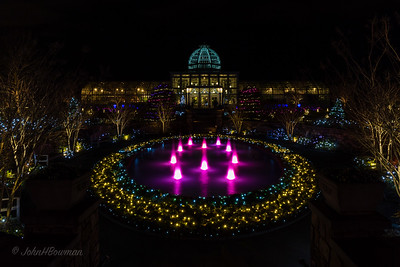 GardenFest of Lights 2013-14, Lewis Ginter Botanical Garden; cold night, with lots of people; Carol & Isabella went with us; polarizer & tripod for all photos, many 30-second exposures, and had to vary aperture and ISO to work within 30-second metering limit; Conservatory with Sunken Garden fountain in foreground