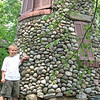 Caleb in front of a stone structure