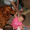 Leah playing with Samson