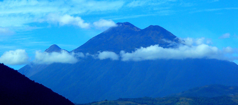 Volcano Acatenango, I think.  If so Volcano Fuego is just behind it and is among the top ten active volcanoes in the world.