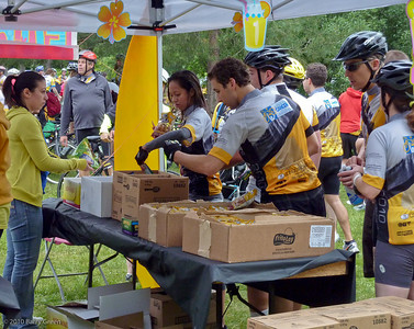 Riders helping themselves to snacks at the first pit stop 24.45 kilometer mark day 1.