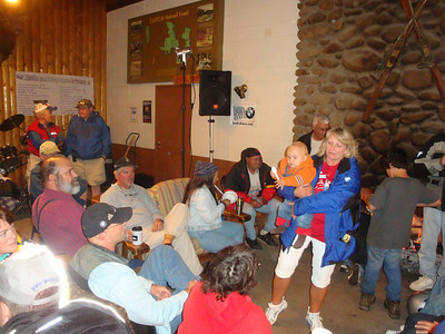 25th Annual Bavarian Mountain Weekend (BMW) Rally @ Sipapu - 2009-09-12...Saturday afternoon inside the lodge with coffee and beer flowing and tales of the trails being shared.  Claire center frame showing of her newly knitted hat!