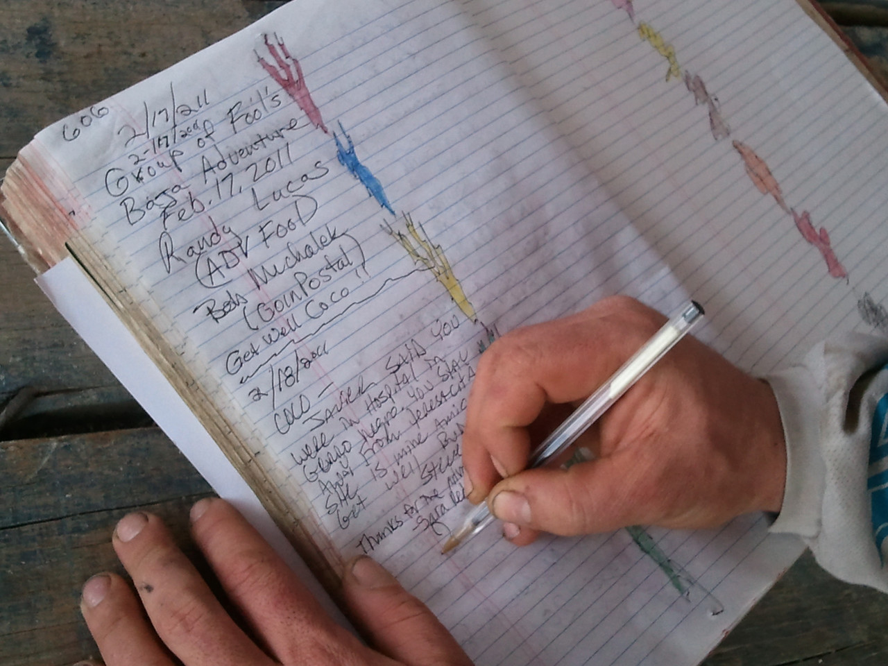 signing coco's journal. note coco's doodling, he is known to doodle in the log books.