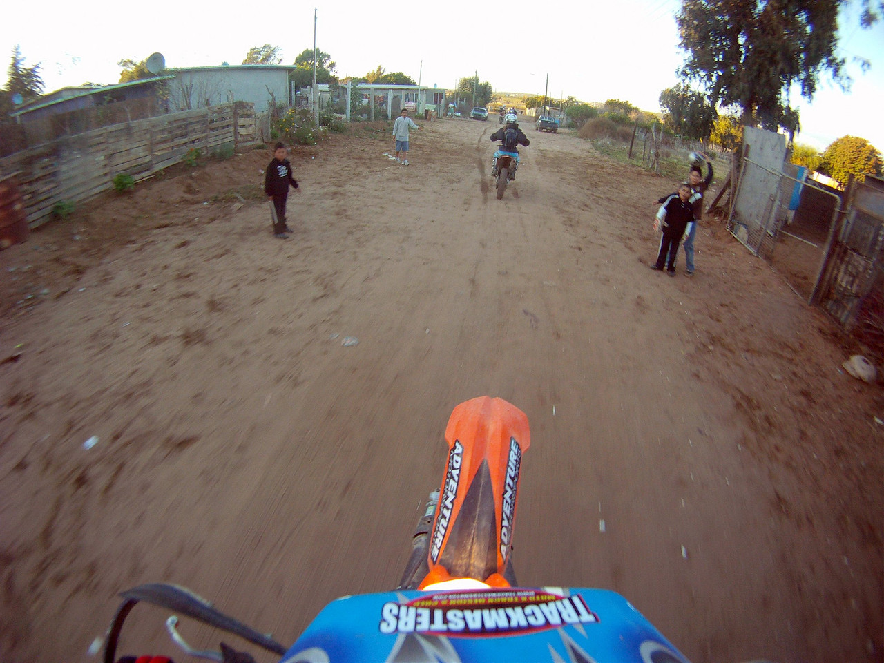 riding out to the baja course and doing some wheelies for the kids