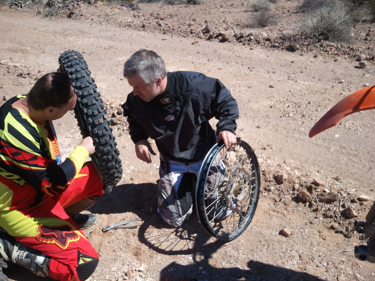 sara obtained a front flat. craig and I inspected the tire for cactus to prevent further flats.