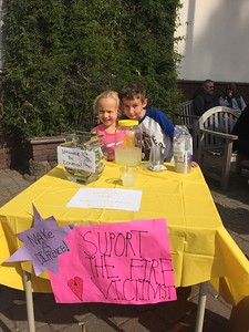 Mike Richards -- contributed Ridgewood Elementary School 2nd grader Jack Fisher (right) and his cousin Bentley sell lemonade in front of Pierson Building Center in Eureka on Sunday to raise funds for Sonoma County fire victims.