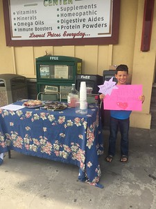 Mike Richards -- contributed Ridgewood Elementary School 2nd grader Dante Landry set up a lemonade and baked goods stand in front of Murphy's Market in Sunny Brae on Sunday to raise funds for Sonoma County fire victims.