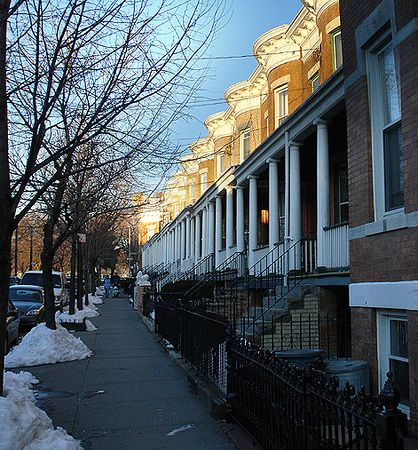Row houses with columned porches. 2005.