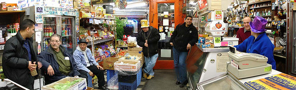"""Da Boyz"" congregate for New Year's Day.  There's a real down home ambience in the deli. 2005."