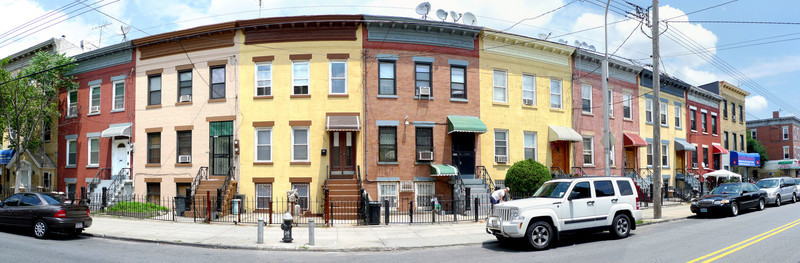 Row houses on St. Nicholas Avenue between Stanhope Street and Himrod Street in the high summer, 2009.