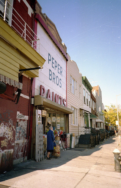 "This paint store was in business in 1955 and earlier.  It's still in operation, only the ""Peper Bros"" is gone, as well as the ""P"" and ""S"" -- thus, today the facade just says ""AINT.""  The store is on Greene Avenue, just yards north of Knickerbocker Avenue."